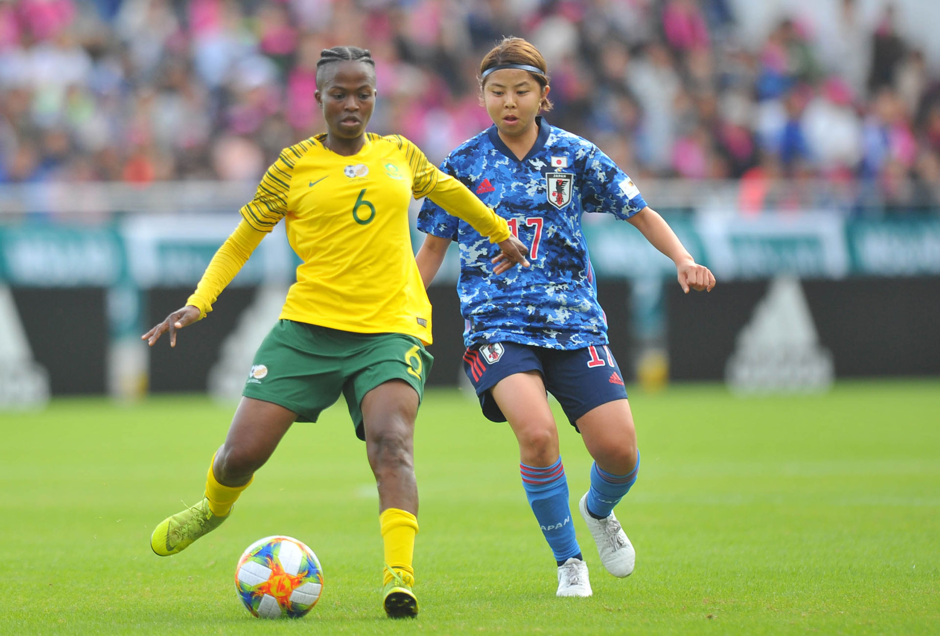 banyana banyana player kicking the ball in the game against japan