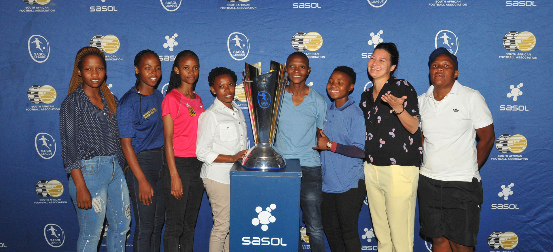 Sasol league team captains with the championship trophy