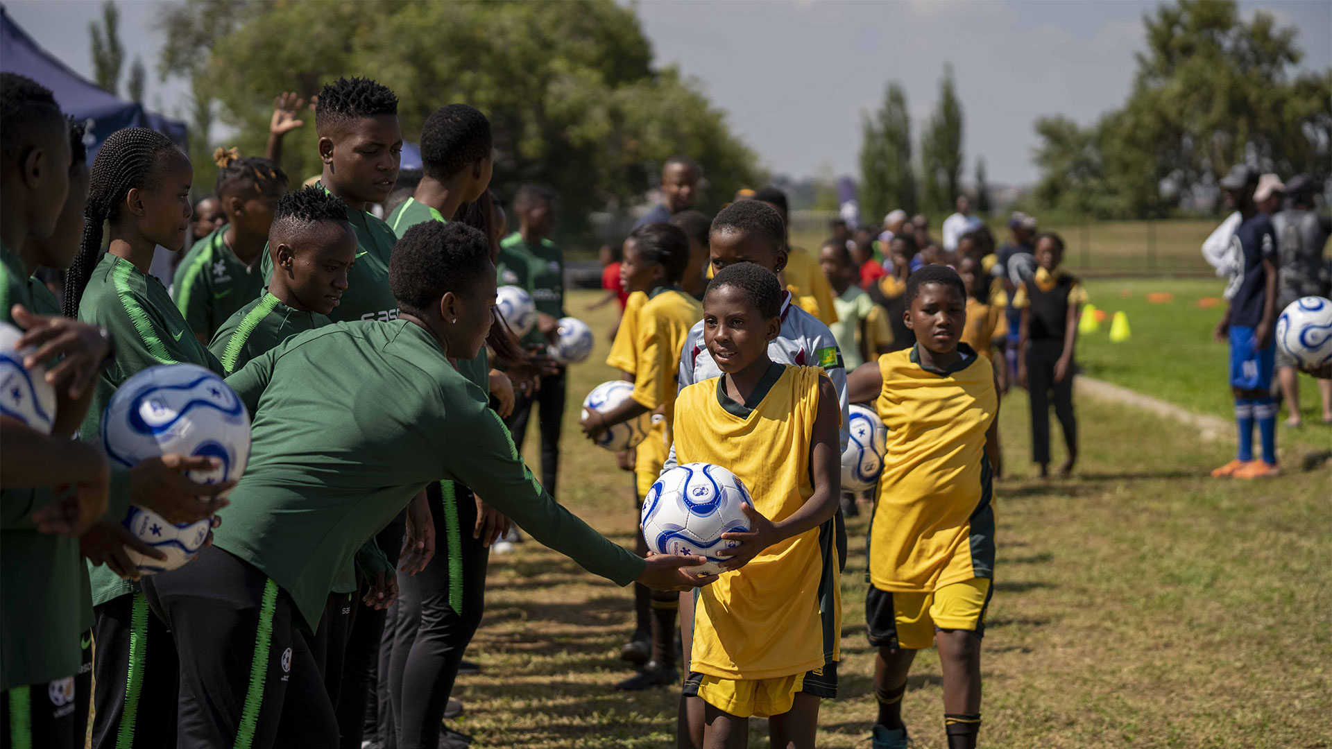 Banyana Banyana players handover balls to girls for limitless